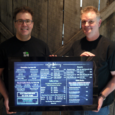 (L to R) Tony Wagner and Markus Doerner, owners of Flook Digital Media pose with one of their digital sign boards.