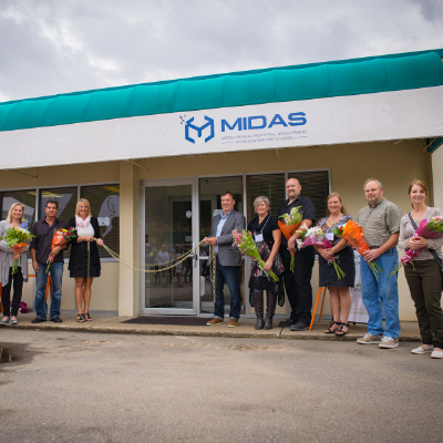 MIDAS employees stand in front of the business