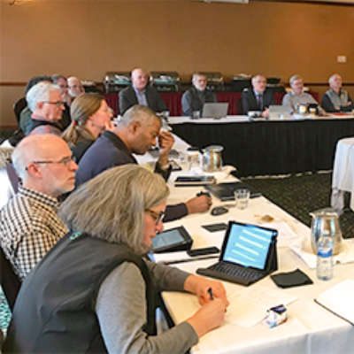Representatives from the seven credit unions attending a December meeting to learn more about the amalgamation currently being explored.