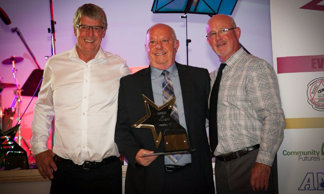 Well-known business owner, Dan Ashman (pictured centre), is dealer principal of AM Ford and was recently awarded Trail's Business Person of the Year Award.