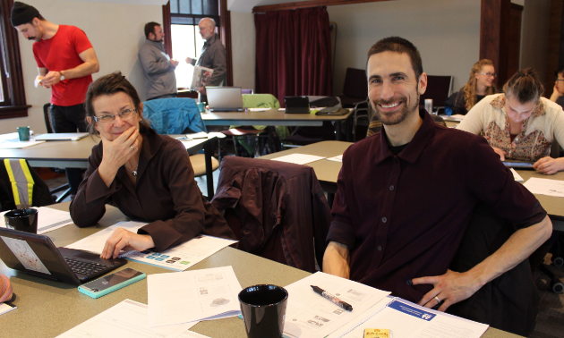 Two students smile while in attendance at an export workshop