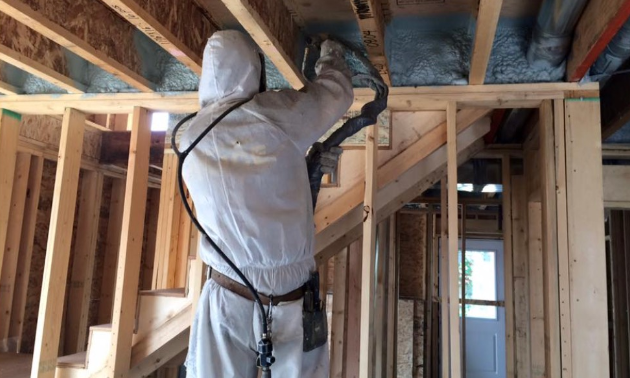 Dan Moberg installs insulation