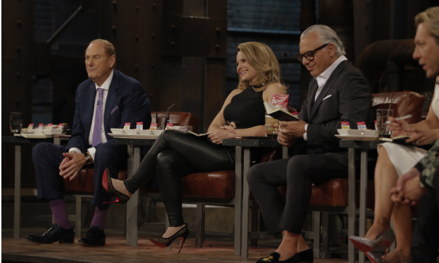 Jim Treliving (left) made a deal with Brenda Palmer on CBC's Dragon's Den.