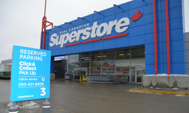 Superstore in Cranbrook is pictured with a sign in the forefront for Click and Collect parking