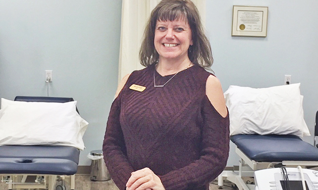 Suzanne Thompson stands in Kootenay Therapy Center.