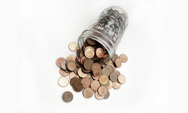 Photo of a jar of pennies spilling