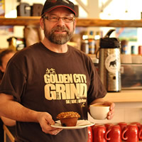 John Snelgrove has a coffee and muffin in the bright atmosphere of Alpine Grind in Rossland, B.C.