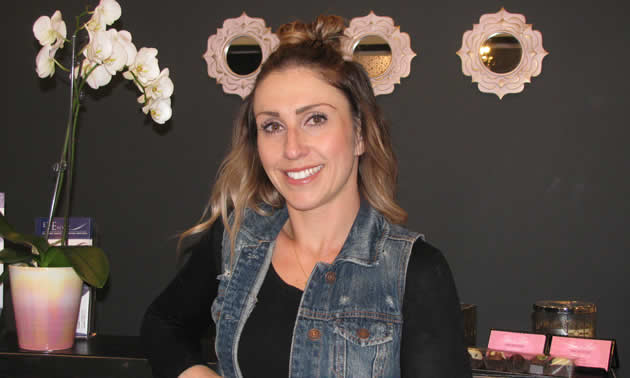 Amy Walker in the black, white and silver decor of Lux & Lace, her new hair salon.