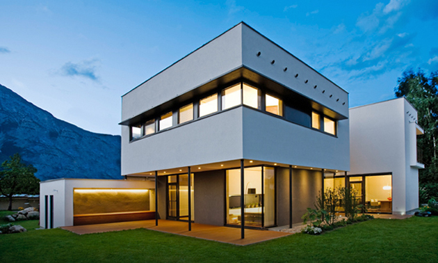 A Graphic Passive Solar Home Rises Attractively Into The Sky. It Is White  And Features