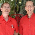Two middle-aged men in red summer Home Hardware shirts