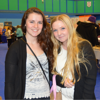 Two students pose for a photo at the College of the Rockies Career and Job Fair.