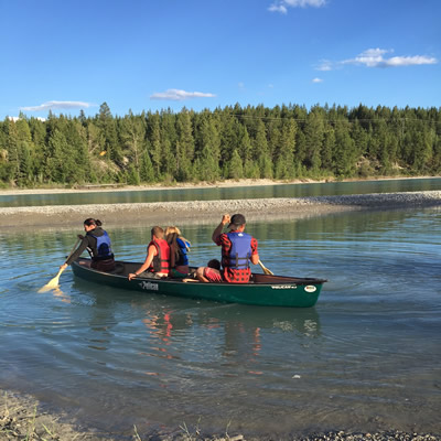 Guests of The Flats RV & Campground launch their canoe onto the adjacent Kootenay River