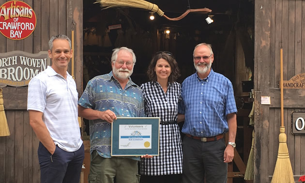 Longtime Community Futures volunteer Rob Schwieger with Community Futures Self-Employment Program Manager, Wade Sather, Executive Director, Andrea Wilkey, and Board Director, Bob Wright.