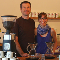 Susi and Colin Thomas stand at the counter of Crumbs Bakery Café in Castlegar, B.C.