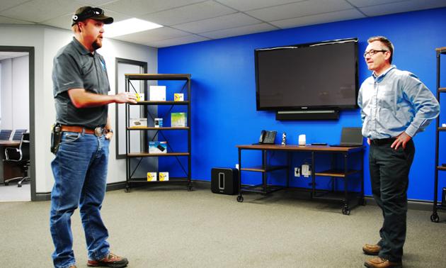 Ryan Doehle demonstrating how to use the Google smart speaker.