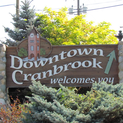Stone and wood make up the Downtown Cranbrook sign that welcomes visitors