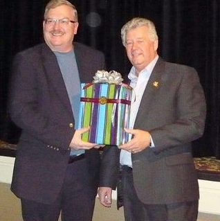 Cranbrook's newest Citizen of the Year, Frank Vanden Broek, was presented with a gift by Mayor Lee Pratt.