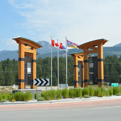 Flags and timber archways form a distinctive landmark at the entrance to Golden, B.C.
