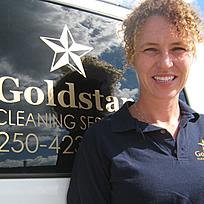 Jill Barclay standing beside the Goldstar van
