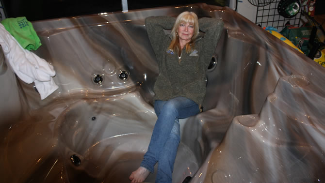 Co-owner Margeaux Bauman of Kootenay Valley Water & Spas in Castlegar sits in one of the many hot tubs the store sells.