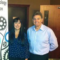 KRIC's Tara Penner poses with sales trainer Ian Selbie after his sales seminar, The 7 Deadly Sins of Selling