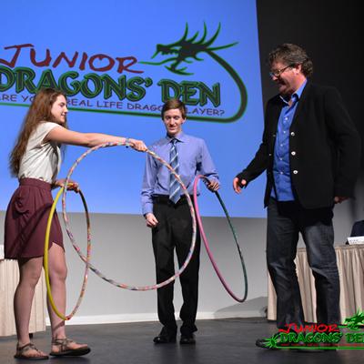 A Junior Dragons Den contestant engages judges Jordan Strobel and Spencer Smith in her demonstration
