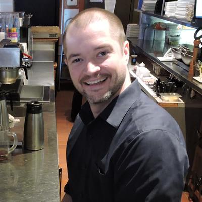 Jordan Perkins, Boston Pizza franchise owner, prepares the restaurant's bar for service in Castlegar, B.C.