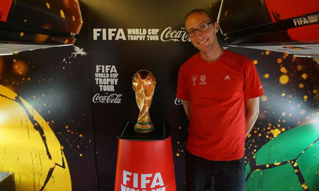Joel Robison, photographer, with the Fifa World Cup trophy