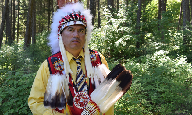Jason Louie, chief of the Lower Kootenay Indian Band, appears in his ceremonial headdress and colourful beaded vest