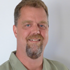 smiling man with trim goatee