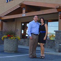 Joey and Christine Hoechsmann stand in front of the Ashley Furniture Homestore in Cranbrook, B.C.