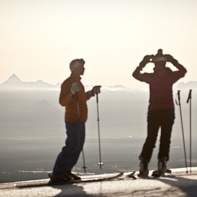 Skiers at Kimberley Alpine Resort are silhouetted in the pristine morning light.