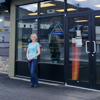 Lori-Ann Dagg stands in front of the doors to Winnipeg Liquor Store in Grand Forks.