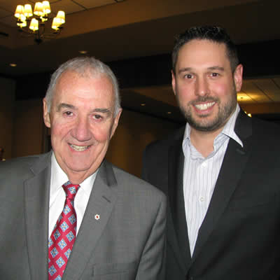 Peter Legge (L), prolific author and chairman and CEO of Canada Wide Media, is pictured here with Chris Botterill, president of the Cranbrook Chamber of Commerce.