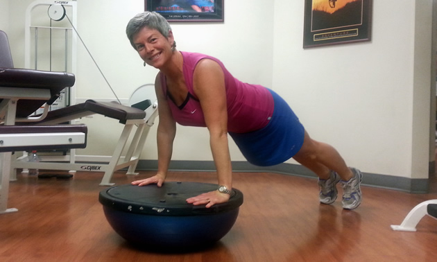 Lori Craig balances on a fitness ball at her business, Better Life Fitness in Rossland.