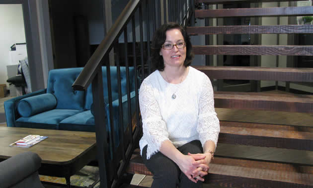 Lynnette Wray sits on the staircase inside the lovely new Ground Floor business complex on Seventh Avenue South in Cranbrook