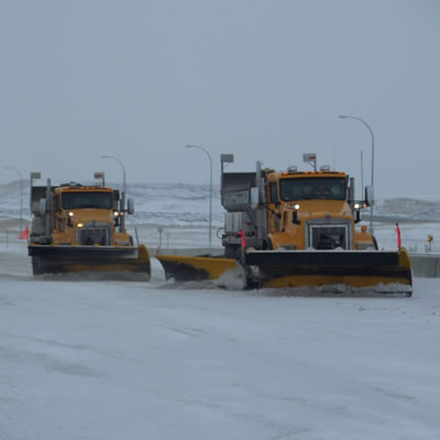 A fleet of Mainroad Contracting's snowplows busy clearing our local highways