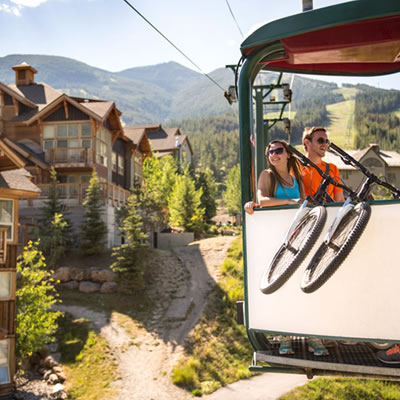Couple with bike on gondola.