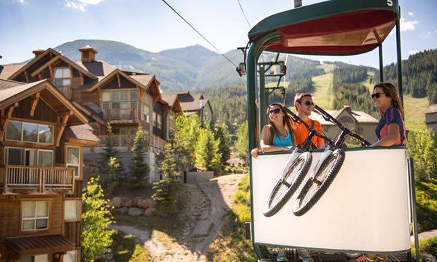 Couple with bike on gondola.