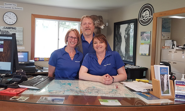 (L to R) Roberta Hall, Kent Kebe and Kara Cassidy welcome people to the Radium Hot Springs Visitor Centre.