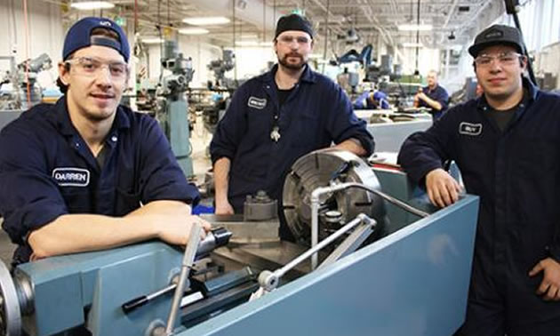 Selkirk College Millwright/Machinist Foundation Program students (L-R) Darren Mederios, Greyson Kozakevich and Guy Vercillo are members of the first cohort to use the newly renovated shop spaces at Nelson's Silver King Campus.