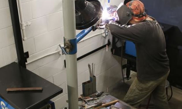 Metal Fabricator Foundation Program student Daniel Secor works on a year-end project in the new welding shop at Nelson's Silver King Campus.