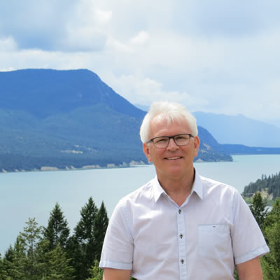Wayne Stetski in standing in front of the Columbia River near its headwaters.