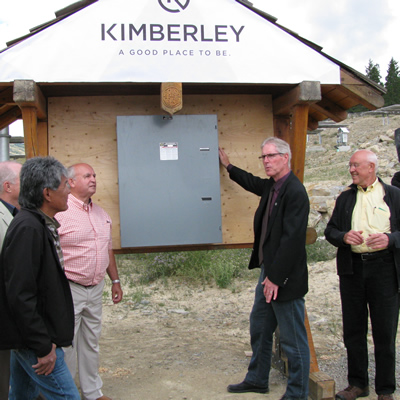 Don McCormick (second from right) prepares to throw the ceremonial switch to activate the SunMine solar panels.