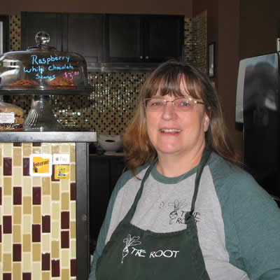 Terry Bedwell, leaseholder and operator of True Root Café stands at the entrance of the eatery.