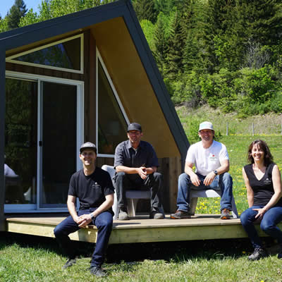 (L to R) Jude Smith, Ian Larsen, Steve Whelan and Rachel Cline enjoy the sunshine on the deck of a Little Cabin.