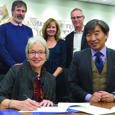 Dr. Catherine Mateer (UVic) and Dr. Stan Chung (College of the Rockies) sign two new partnership agreements as (L-R) deans of instruction Heather Hepworth and Darrell Bethune, director of student affairs Doris Silva and dean of instruction Jack Moes look on.