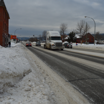 Vehicles drive down Highway 95 in Cranbrook.