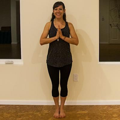 Chelsea McCormack strikes a standing pose in her new yoga studio, The Inner Roar.