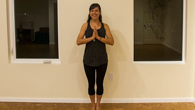 Chelsea McCormack strikes a standing pose in her new yoga studio, The Inner Roar.